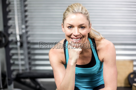 smiling fit woman sitting