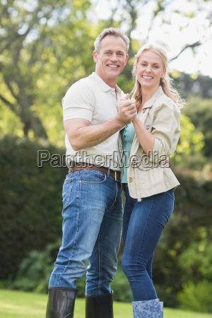 cute couple dancing and holding hands