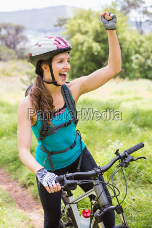 smiling woman on her bike