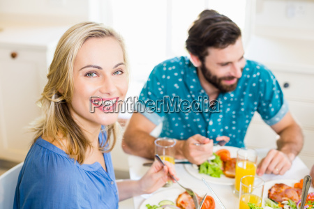 beautiful young woman sitting at dining