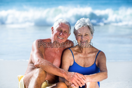 cute mature couple sitting on the
