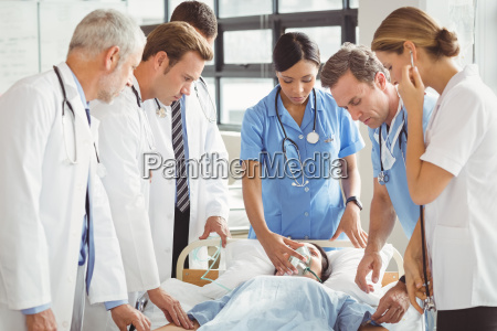 doctors examine female patient