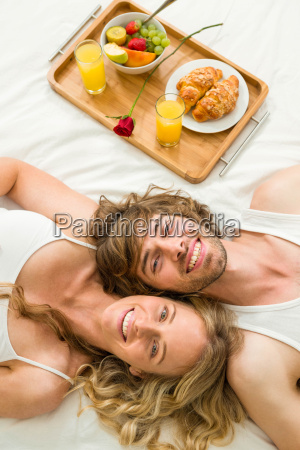 cute couple lying in bed next