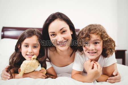 happy woman with children lying on