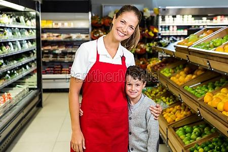 female worker posing with little boy
