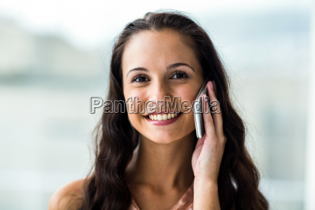 smiling woman on phone call looking