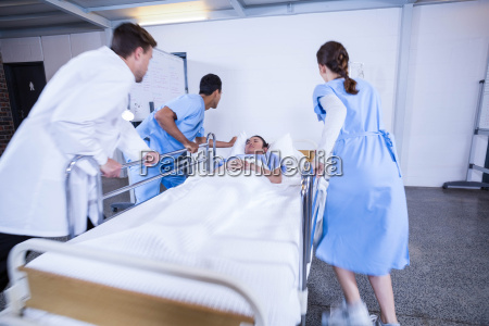 doctors standing near patient bed