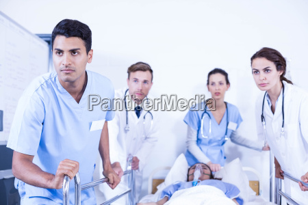 concerned doctors standing near patient on