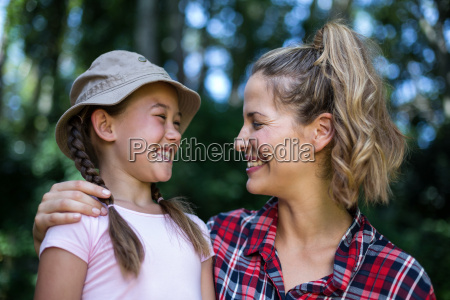cheerful mother looking at daughter