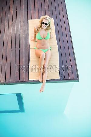 beautiful woman in green bikini relaxing