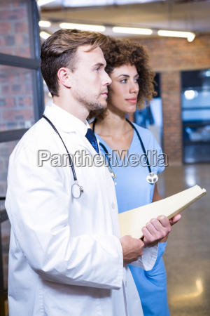 doctor and nurse with medical report