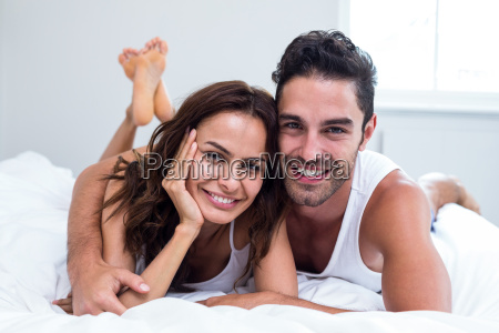 portrait of smiling couple lying on