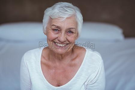 portrait of senior woman on bed