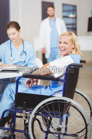 portrait of cheerful female doctor sitting