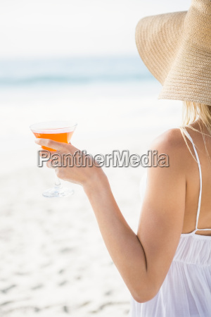 blonde woman drinking cocktail