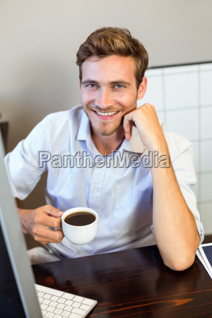 portrait of young man holding coffee