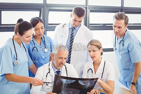 medical team examining an x ray