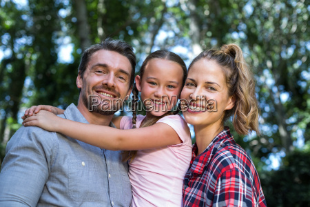 portrait of father carrying daughter with