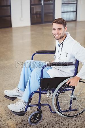portrait of happy doctor sitting on