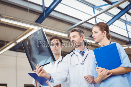 concentrated doctors examining x ray