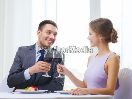 couple with main course and red