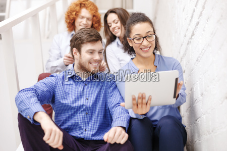 team with tablet pc computer sitting