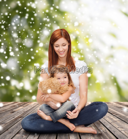 happy mother with little girl and