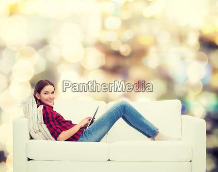 teenage girl sitting on sofa with