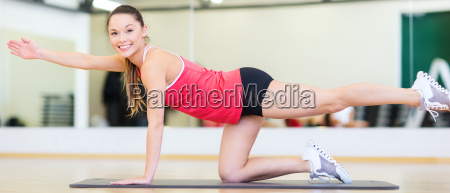 beautiful sporty woman doing exercise at