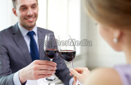 happy couple with glasses of wine