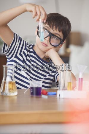 boy wearing protective eyewear looking at