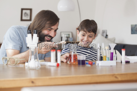 father and son working on school
