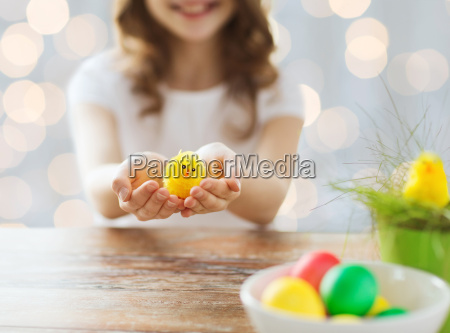 close up of girl holding easter