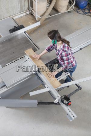 a female carpenter using a sliding