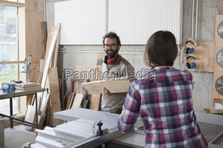 male and female carpenters working together