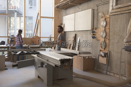 male and female carpenters working in