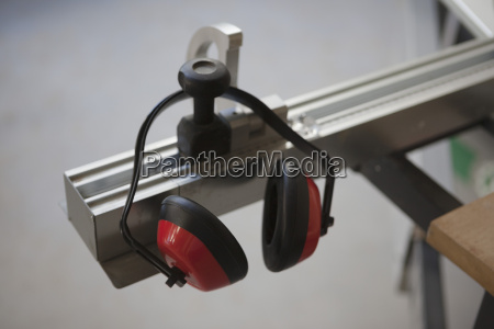 ear protector hanging from sliding table