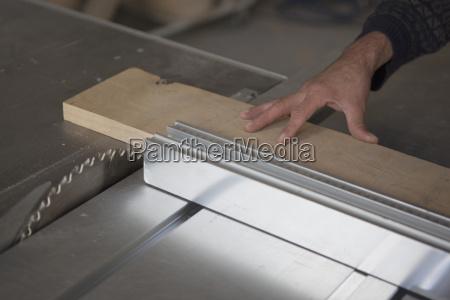cropped image of carpenter using sliding