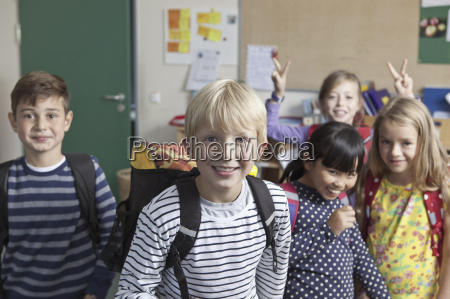students having fun together in classroom
