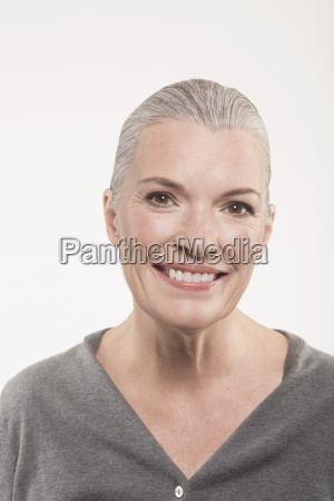 portrait of happy mature woman against