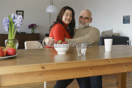 portrait of happy mature couple embracing