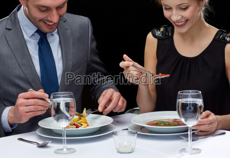 close up of couple eating at