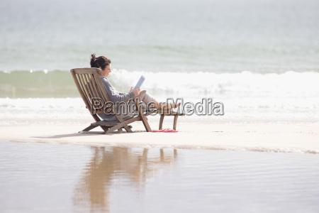 older woman using digital tablet in