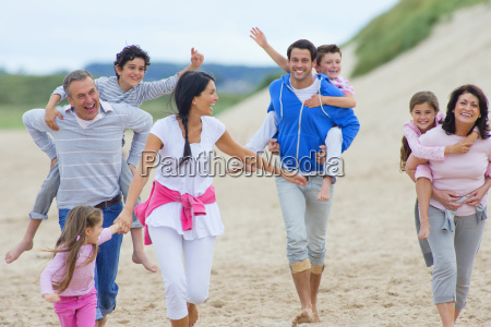 multi generation family walking together on