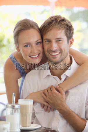 portrait of couple smiling at camera