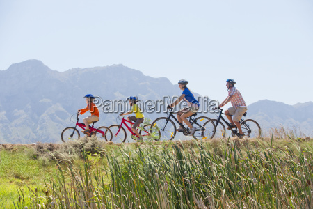 family riding mountain bikes in the