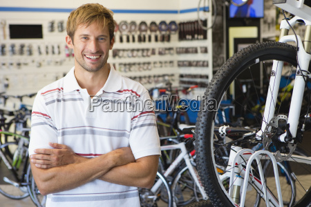 store manager or customer in bicycle