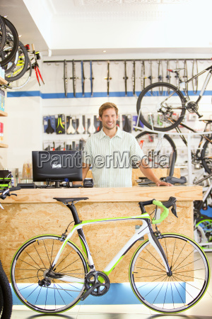 store manager behind counter in bicycle