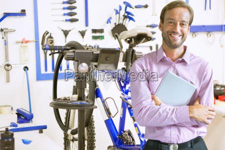 shop owner in bicycle workshop