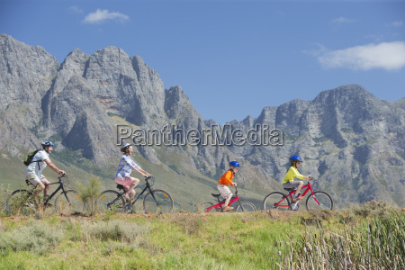 family cycling on mountain track